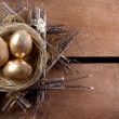 Three golden eggs in a nest — Stock Photo #9410567