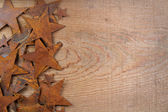 Rusty stars on a wooden background — Stok fotoğraf