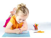 Little girl coloring a rainbow — Stock Photo