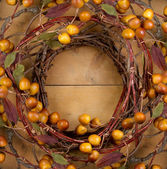A rustic wreath on a wooden background — Stock Photo