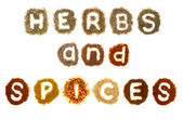 Assorted herbs and spices spelling the words — Stock Photo