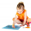 A young girl coloring a rainbow isolated — Stock Photo