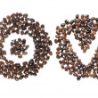 Coffe beans used to spell the word love — Stock Photo