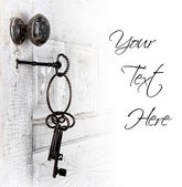 Antique door with keys in the lock — Stock Photo