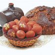Stock Photo: Fresh loaf, eggs and krashnnye dekorrativry barrel of wine