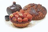 The fresh loaf, eggs and krashnnye dekorrativry barrel of wine — Stock Photo