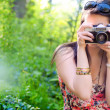 Pretty sexy brunette girl taking picture with an old camera — Foto Stock