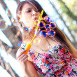 Portrait of a girl blowing bubbles in the wind - Stock Photo