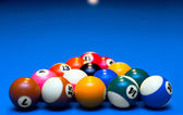 Pool balls triangle isolated on blue — Stock Photo