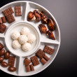 Stock Photo: Small chocolate flavors isolated on dark background