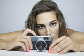 Woman with photography camera — Stock Photo