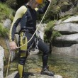 Stock Photo: Instructor canyoning