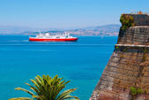 Ferry boat and fortress wall — Stock Photo