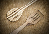 Wooden spoons on mat — Stock Photo