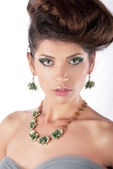 Luxurious hair model beautiful brunette with necklace closeup — Stock Photo