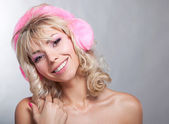 Beautiful bare blonde in pink headphones smiling - studio shot — Stock Photo