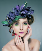 Attractive sexy young woman fashion model in wreath of flowers — Stock Photo