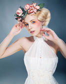 Lovely blonde princess with wreath of flowers on her head — Stock Photo