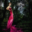 Beautiful nymph blonde on staircase in mysterious forest — Stock Photo