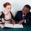 Stock Photo: Education - black american man and redhead young woman
