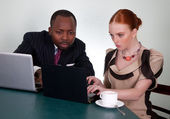 Business conversation between black man and redhead woman — Stock Photo