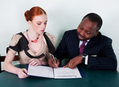 Education - black american man and redhead young woman — Stock Photo