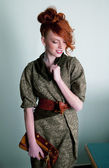 Sensual gentle redhair fashion model posing in office space — Stock Photo