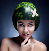 Pretty cute - young girl with watermelon as hard hat close up — Stock Photo