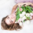 Dreaming lovely young girl with bouquet of flowers - Stock Photo