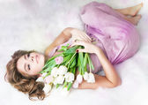 Romantic lovely young girl with bouquet of fresh tulips — Stock Photo