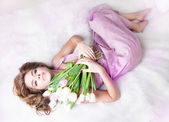 Pretty sexy gentle young woman with bouquet of fresh tulips — Stock Photo