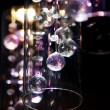 Abstract bright transparent glass balls on dark background — Stock Photo