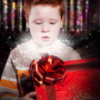 Birthday - lovely excited little kid looks happily into red gift — Stock Photo #8722093