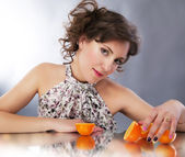 Pretty young woman with oranges reflects in mirror - series of photos — Stock Photo