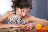 Beautiful woman with citrus. Studio shot, series of photos — Stock Photo