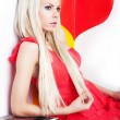 Sexy young female blonde posing in studio over red heart — Stock Photo
