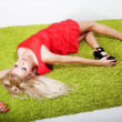Lovely woman blonde hair laying in grass — Stock Photo