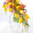 Colorful flowers bouquet arrangement centerpiece in transparent vase — Stock Photo