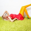 Seductive laying gorgeous sexy woman on green rug — Stock Photo