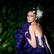Evening scene - beauty fashion girl sitting in bushes — 图库照片