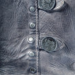Royalty-Free Stock Photo: Gray leather texture background with buttons close up
