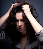 Stress - young stressed female brunette posing — Stock Photo