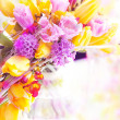 Vernal flowers bouquet over blurred background — Stock Photo
