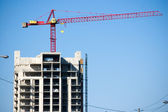 Crane on top of building — Stock Photo