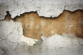 Peeled white stucco on cement wall — Stock Photo