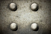 Bolts on grunge textured — Stock Photo
