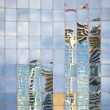 Street reflecting in the glass of modern building - Stock Photo