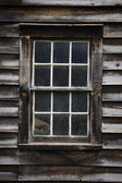 Window on a weathered wooden wall — Foto Stock