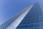 Close up of modern skyscraper / abstract building background / glass reflec — Stock Photo