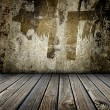 Room with cement wall and wooden floor - Stock Photo